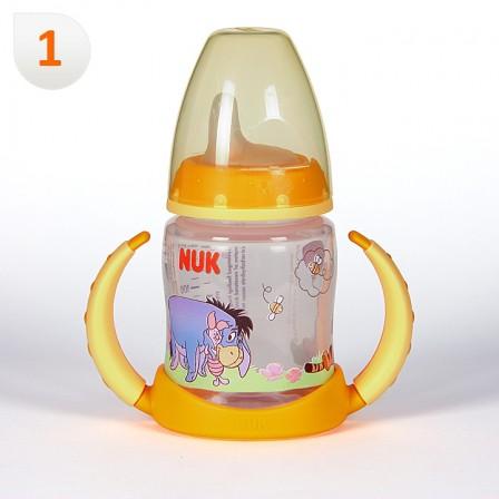 Farmacia Jiménez | Nuk Biberón Entrena Winnie de Pooh Boquilla Blanda +6 meses 150 ml